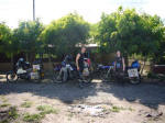 Three English bikers having afternoon coffee at a Nicaraguan Little Chef